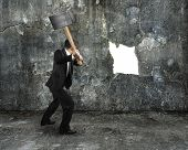 Businessman Hold Sledgehammer Cracking Big White Hole On Concrete Wall