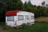 old camper near forest