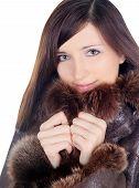 Pretty Brunette In Fur Over White