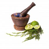 Wooden pounder with flowers and lime isolated