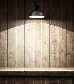 Empty wooden shelf under the lamp