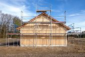 Scaffolding at a new wooden house