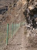 Rocks Pathway With Fence In The Mountain