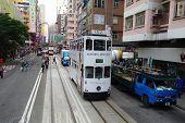 Unidentified People Using City Tram In Hong Kong