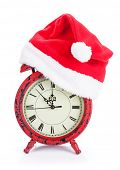Christmas clock with santa hat. Isolated on white background