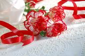 carnation and red ribbon