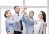 success, business, office and winning concept - happy business team giving high five in office