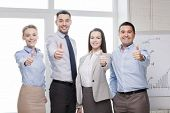 success, business, office and winning concept - happy business team showing thumbs up in office