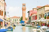 People walking in the city of Murano