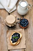 Bread With Blueberry Jam On Wooden Table