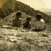 Vintage photo of people resting during a mountain trekking, fifties