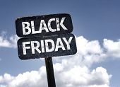 Black Friday sign with clouds and sky background