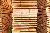 Stack of new wooden studs at the lumber yard