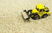 Front loader toy on sand
