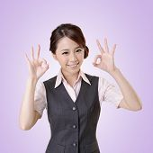 Asian business woman give you OK gesture, close up portrait with clipping path.