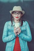 Young Beautiful Girl In Hat With Cup Of Coffee
