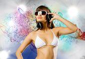 Attractive girl in white bikini and headphones