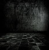 Very dark and dim stone or concrete room.