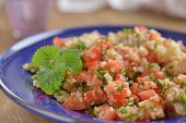 Tabbouleh with quinoa, tomato, chives, and mint