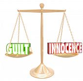 stock photo of innocence  - Guilt vs Innocence 3d words on a gold scale to weigh choices or decisions - JPG