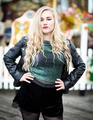 picture of nylons  - Portrait of a confident blond teenager with long hair wearing a leather jacket green glittery t - JPG