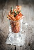 pic of bacon strips  - Fried Bacon Strips With Fresh Rosemary On The Wooden Table - JPG