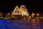 Illuminated house of the Blackheads at night in Riga, Latvia
