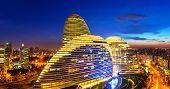 Beijing,China-July 13th,2014:cityscape and famous landmark building,WangJing Soho at night.