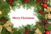 Beautiful Christmas border from fir and mistletoe on white background