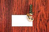 Christmas Snowman Clothespins Holding White Paper Card