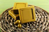 Bars of natural soap  with olive oil on wicker mat background