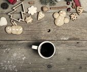 Christmas decorations, home made ginger bread and  mulled wine on rustic wooden background