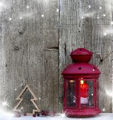 Christmas lantern on rustic wooden background