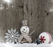 Christmas decorations on rustic wooden background