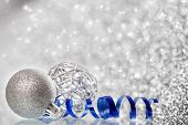 Sparkling Christmas background with silver Christmas decorations