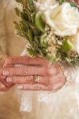 Older Bride Holding Bouquet