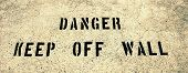Danger keep off wall