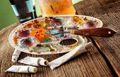 stock photo of putty  - Professional acrylics paints with artistic putty knife on wooden board - JPG