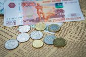 image of ten thousand dollars  - russian roubles banknotes and euro and dollars coins