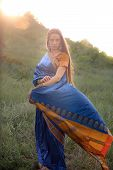 image of indian sari  - Beautiful girl in traditional Indian sari on temple background - JPG