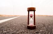 pic of time-bomb  - Time Concept Alarm Hourglass on the Asphalt Street - JPG