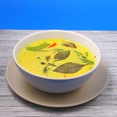 picture of curry chicken  - Hot and spicy chicken green curry on a blue background on a wood table top - JPG