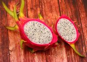 pic of dragon fruit  - a dragon fruit on a wood table top - JPG