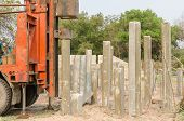 picture of piles  - pile driver driving precast concrete piles on a construction site - JPG