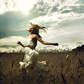 Girl Running Across Field