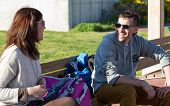 stock photo of skate  - Couple of friends ready to skate on a spring afternoon - JPG
