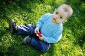 Little Boy Outdoors poster