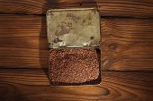 stock photo of cocoa beans  - grated dark chocolate in tin with cocoa beans and solid piece in old texured wood - JPG
