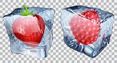 image of frozen  - Two transparent ice cubes with frozen strawberry and raspberry - JPG
