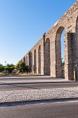 stock photo of aqueduct  - Ancient Roman aqueduct in Evora in afternoon sun Portugal - JPG